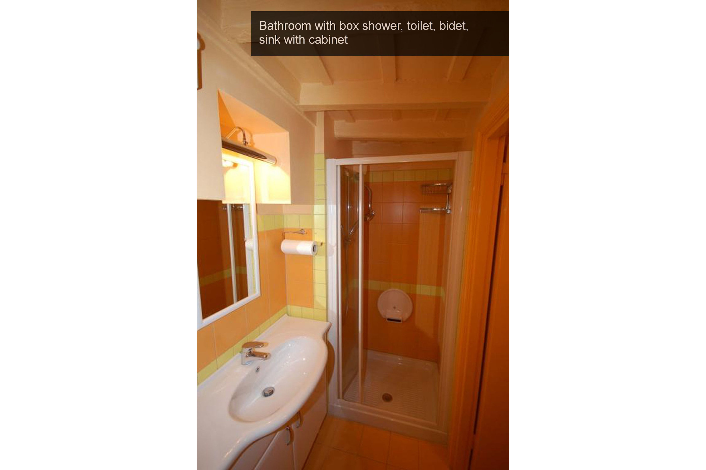 11) bathroom with box shower, toilet, bidet, sink with cabinet