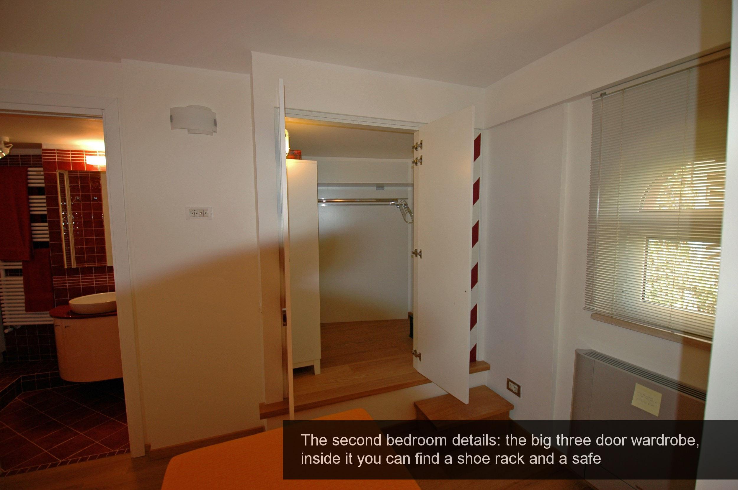18) Details wardrobe, shoe rack and a safe, second bedroom