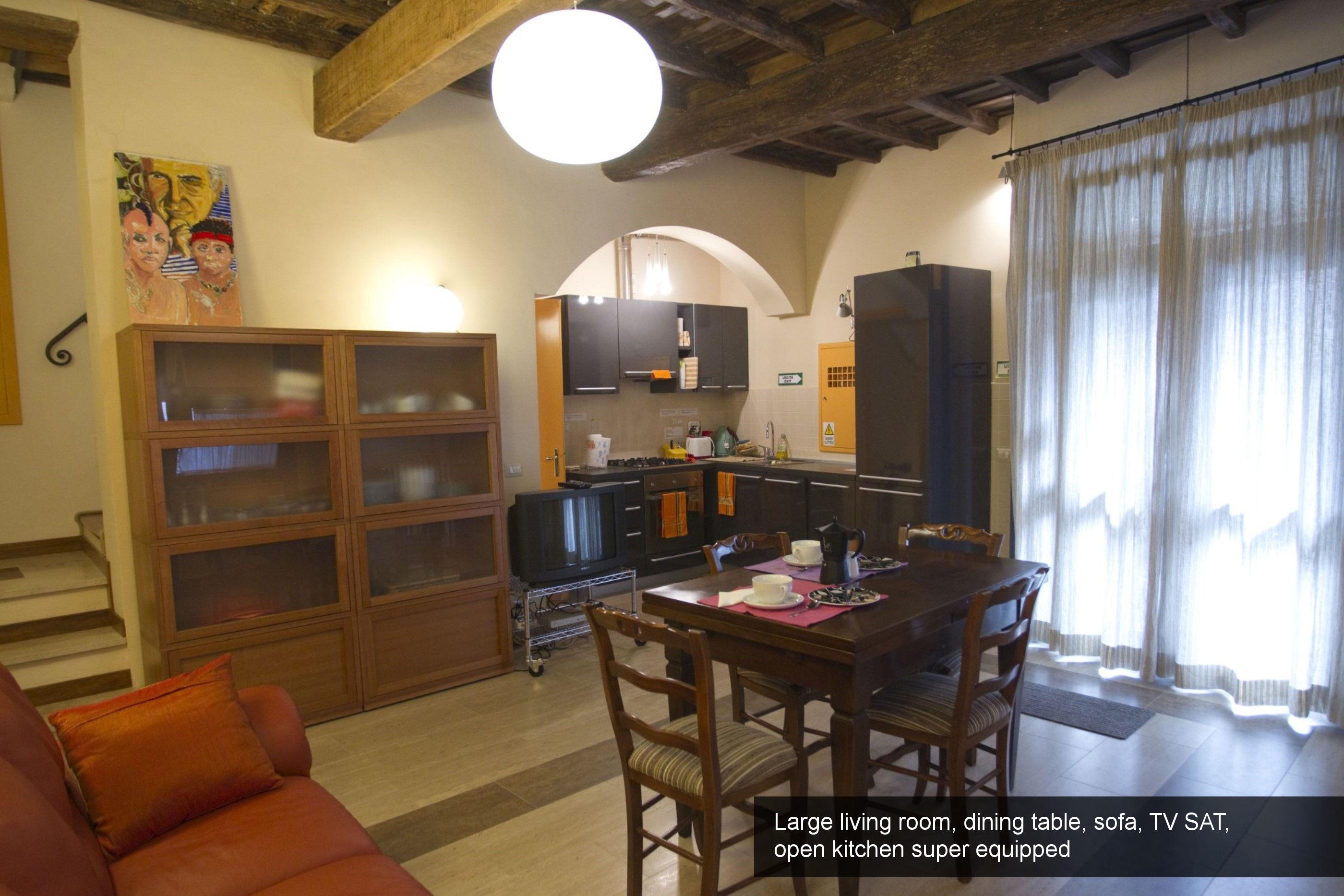 2) large living room, dining table, sofa, TV SAT, open kitchen super equ...