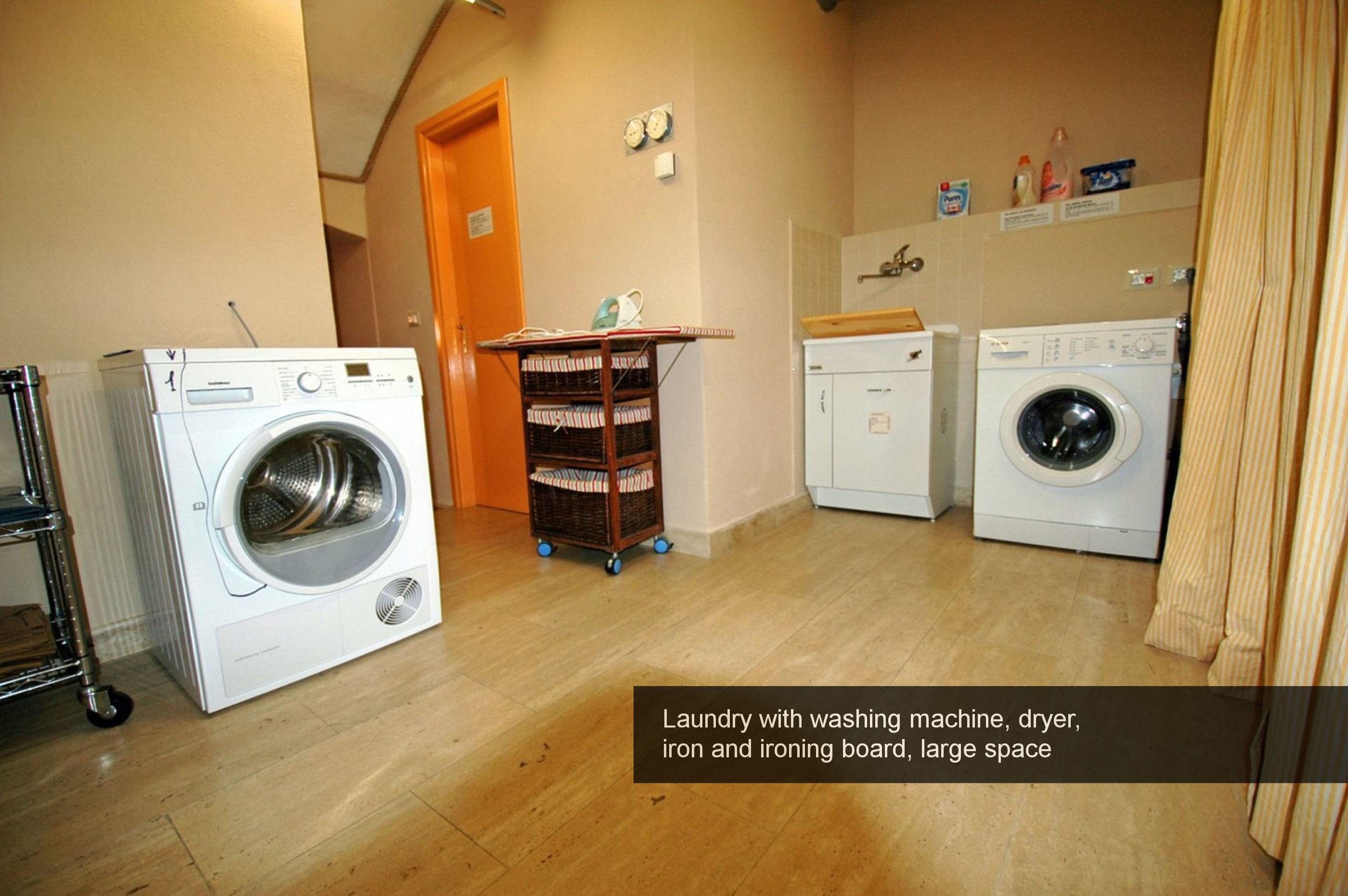 20) Laundry, washing machine, dryer, iron and ironing board, large space...