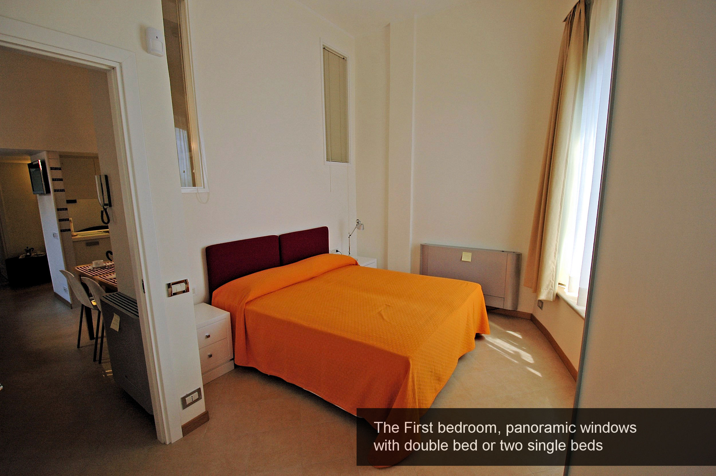 3) First bedroom, panoramic windows with double bed or two single beds