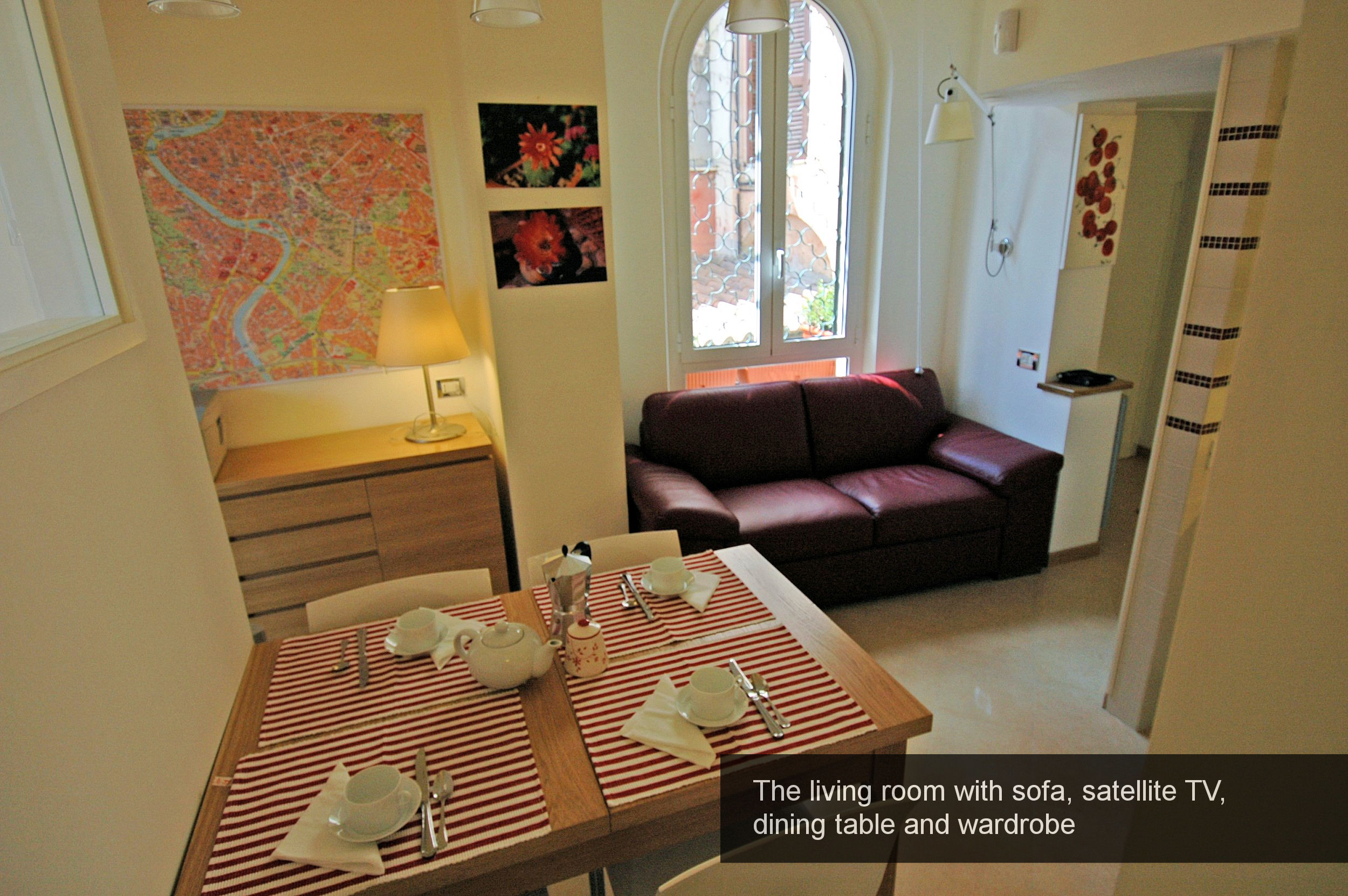 7) living room with sofa, satellite TV, dining table and wardrobe